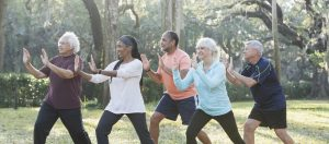 older-adults-tai-chi-outside-e1505160556655