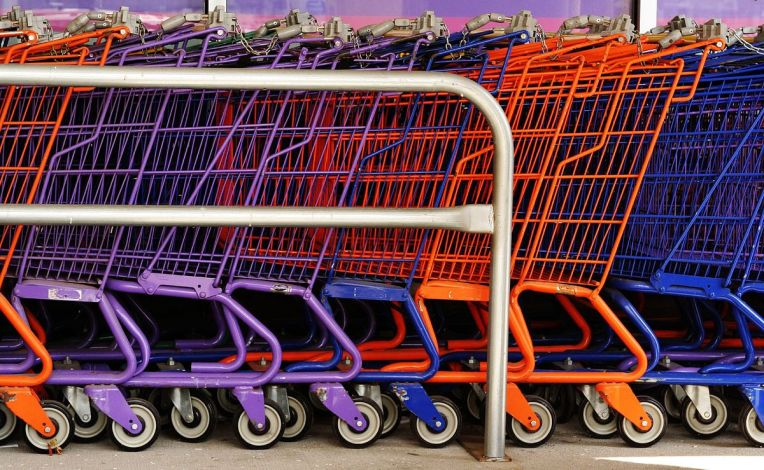 1200px-Colourful_shopping_carts