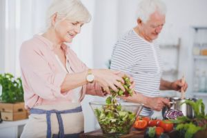 iStock-Older couple making salad small