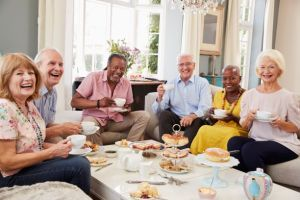 iStock-Older friends enjoying meal small