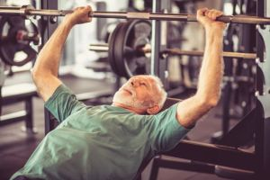 iStock Older man lifting weights small